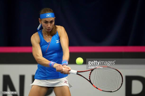 Aleksandra Krunic of Serbia plays a backhand during her promtional playoff match against Johanna Konta of Great Britain on day four of the Fed Cup...