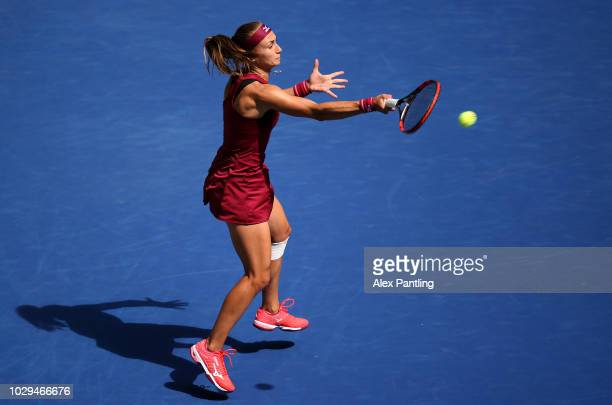 Aleksandra Krunic of Serbia plays a backhand during her women's singles third round match against Madison Keys of the United States on Day Six of the...