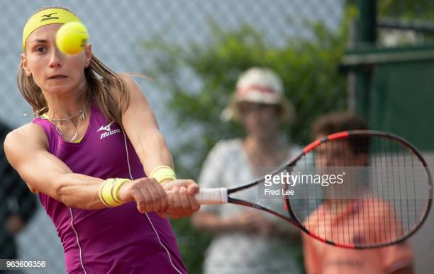 Aleksandra Krunic of Serbia plays a backhand during the ladies singles first round match against Peng Shuai of China during day three of the 2018...