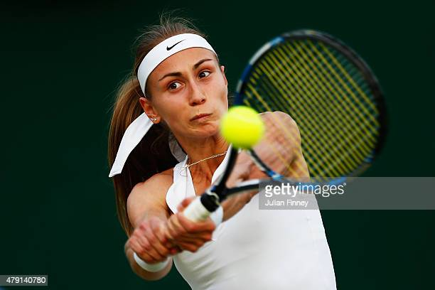 Aleksandra Krunic of Serbia plays a backhand in her Ladies Singles Second Round match against Sara Errani of Italy during day three of the Wimbledon...