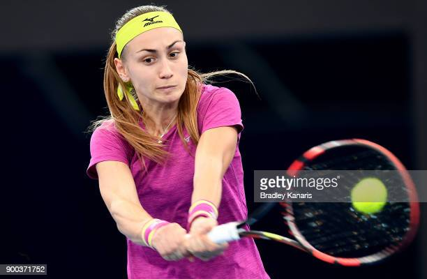 Aleksandra Krunic of Serbia plays a backhand in her match against Garbine Muguruza of Spain during day three of the 2018 Brisbane International at...