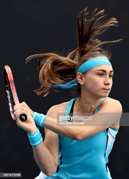 Aleksandra Krunic of Serbia plays a backhand in her Women's Doubles second round match with partner Martina Trevisan of Italy against Mona Barthel of...
