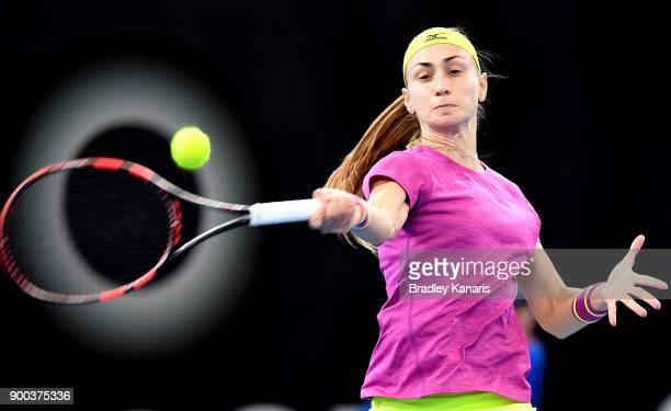 Aleksandra Krunic of Serbia plays a forehand in her match against Garbine Muguruza of Spain during day three of the 2018 Brisbane International at...
