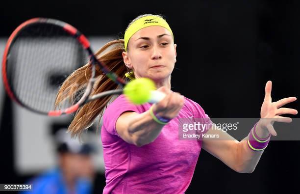Aleksandra Krunic of Serbia plays a forehand in her match against Garbine Muguruza of Spain during day three of the 2018 Brisbane International at...