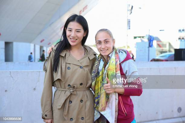 Aleksandra Krunic of Serbia poses for a picture with with the organizer of the Little Painter event on day three of 2018 China Open at the China...