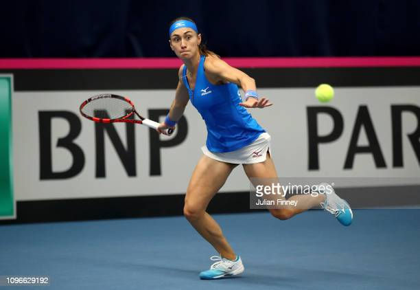 Aleksandra Krunic of Serbia reaches for a forehand during her promtional playoff match against Johanna Konta of Great Britain on day four of the Fed...