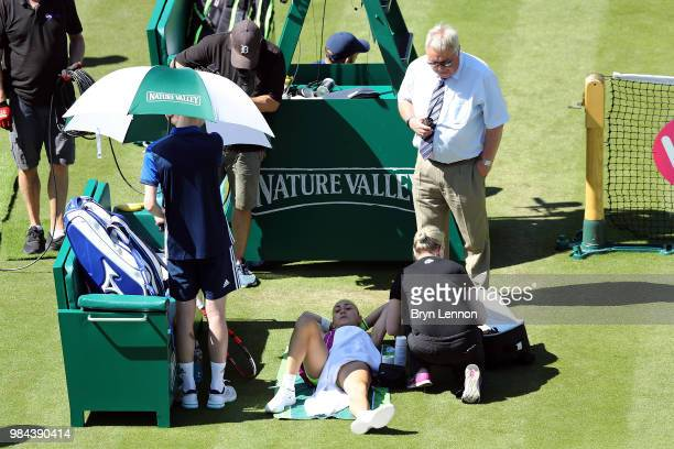 Aleksandra Krunic of Serbia receives medical treatment during her match against Johanna Konta of Great Britain on day five of the Nature Valley...