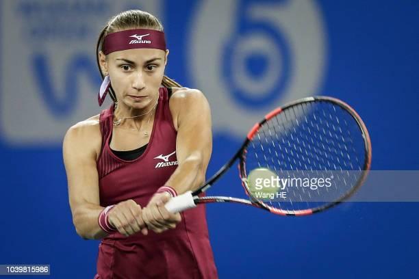 Aleksandra Krunic of Serbia returns a shot against Petra Kvitova of Czech during 2018 Wuhan Open at Optics Valley International Tennis Center on...