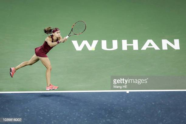Aleksandra Krunic of Serbia returns a shot against Petra Kvitova of Czech during 2018 Wuhan Open at Optics Valley International Tennis Center on...