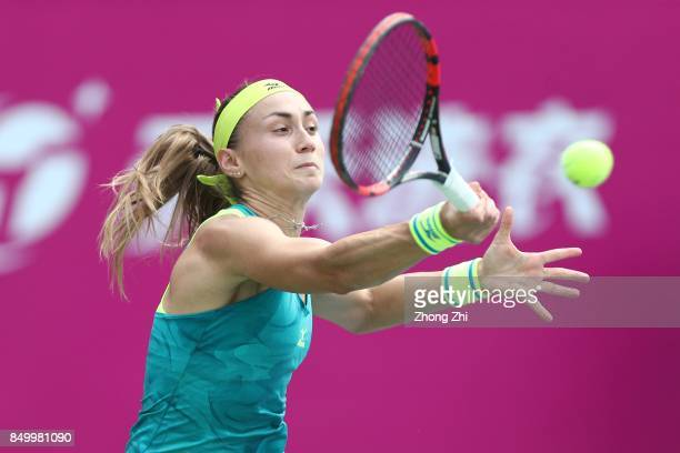 Aleksandra Krunic of Serbia returns a shot during the match against Mona Barthel of Germany on Day 3 of WTA Guangzhou Open on September 20 2017 in...