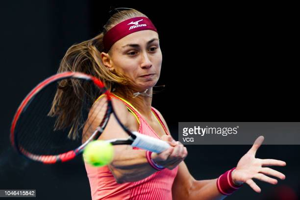 Aleksandra Krunic of Serbia returns a shot in the Women's Singles first round match against Elina Svitolina of Ukraine on day one of the 2018 China...