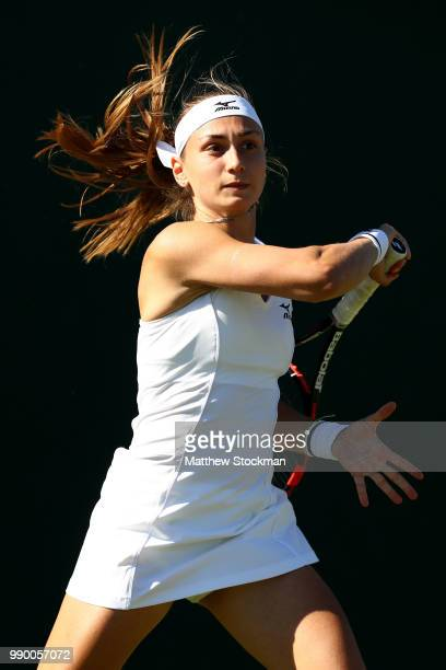 Aleksandra Krunic of Serbia returns against Madison Brengle of the United States during their Ladies' Singles first round match on day one of the...