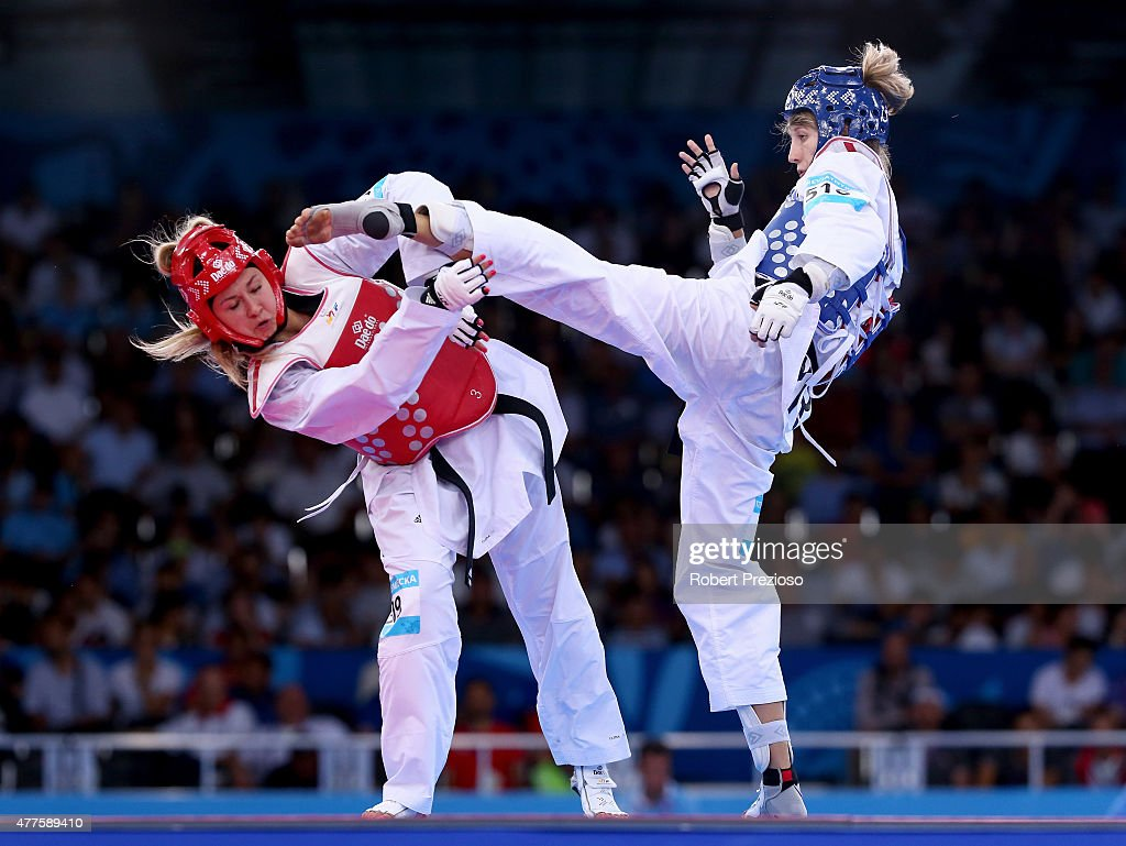 Aleksandra Krzemieniecka of Poland (red) and Tetiana Tetereviatnykova of Ukraine (blue) compete during the Women's Taekwondo -67kg repecharge on day six of the Baku 2015 European Games at the Crystal Hall on June 18, 2015 in Baku, Azerbaijan.