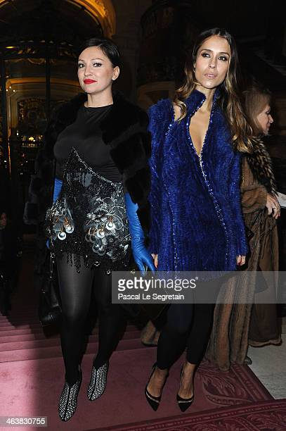 Aleksandra Melnichenko and a guest attend the Atelier Versace show as part of Paris Fashion Week Haute Couture Spring/Summer 2014 on January 19 2014...