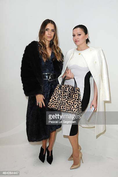 Aleksandra Melnichenko and a guest attend the Christian Dior show as part of Paris Fashion Week Haute Couture Spring/Summer 2014 on January 20 2014...