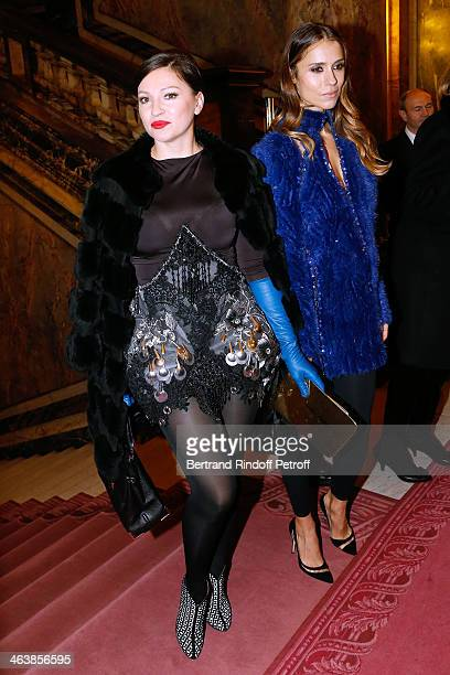 Aleksandra Melnichenko and Guest attend the Atelier Versace show as part of Paris Fashion Week Haute Couture Spring/Summer 2014 on January 19 2014 in...