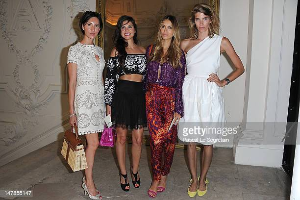 Aleksandra Melnichenko and guests attend the JeanPaul Gaultier HauteCouture show as part of Paris Fashion Week Fall / Winter 2012/13 on July 4 2012...