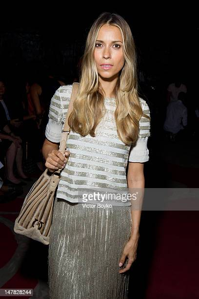 Aleksandra Melnichenko attends the Ulyana Sergeenko HauteCouture Show as part of Paris Fashion Week Fall / Winter 2013 at Theatre Marigny on July 3...