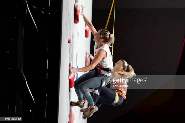 Aleksandra Miroslaw of Poland and Petra Klingler of Switzerland compete in the Speed during Combined Women's Final on day ten of the IFSC Climbing...