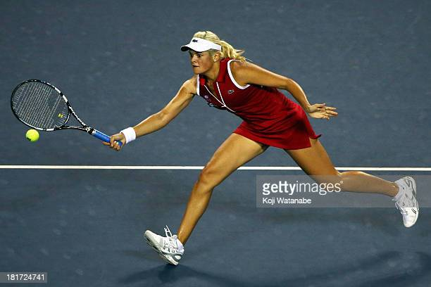 Aleksandra Wozniak of Canada in action during her women's singles second round match against Agnieszka Radwanska of Poland during day three of the...