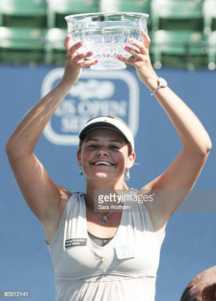 Aleksandra Wozniak of Canada lifts the tournament trophy after defeating Marion Bartoli of France in the singles final at the Bank of the West...