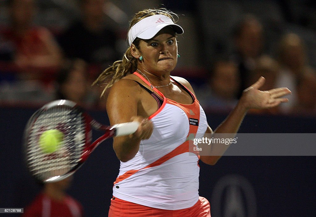 Aleksandra Wozniak of Canada returns a shot against Jelena Jankovic of Serbia during Day 3 of Rogers Cup Tennis on July 30,2008 at Stade Uniprix in Montreal, Quebec, Canada. Jankovic defeated Wozniak 6-0, 6-4.