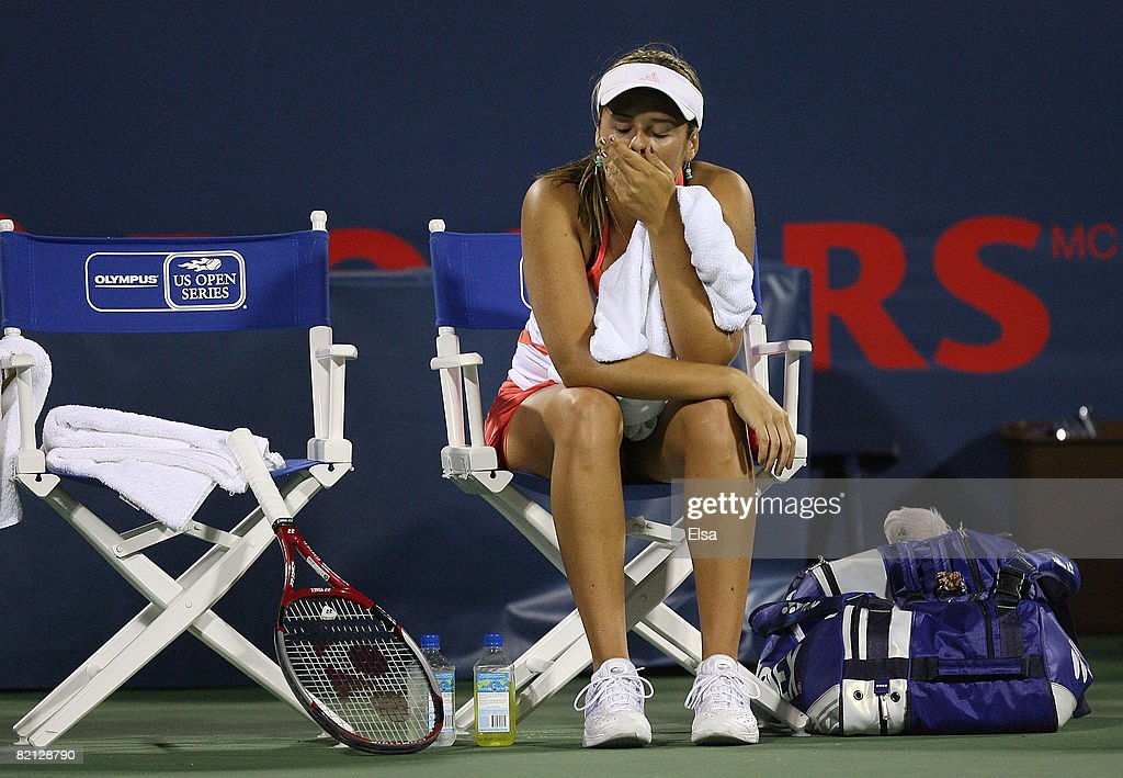 Aleksandra Wozniak of Canada sits after a rough first set against Jelena Jankovic of Serbia during Day 3 of Rogers Cup Tennis on July 30,2008 at Stade Uniprix in Montreal, Quebec, Canada. Jankovic defeated Wozniak 6-0, 6-4.