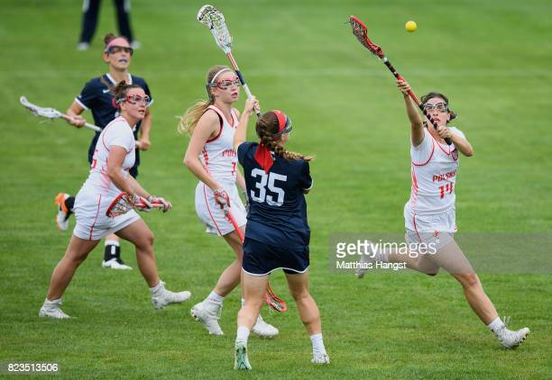 Aleksandra Zbikowski saves the ball against Michelle Tumolo of the United States during the Lacrosse Women's match between USA and Poland of The...