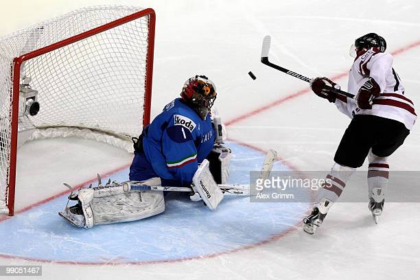 Aleksandrs Nizivijs of Latvia tries to score with a penalty against goalkeeper Adam Russo of Italy during the IIHF World Championship group C match...