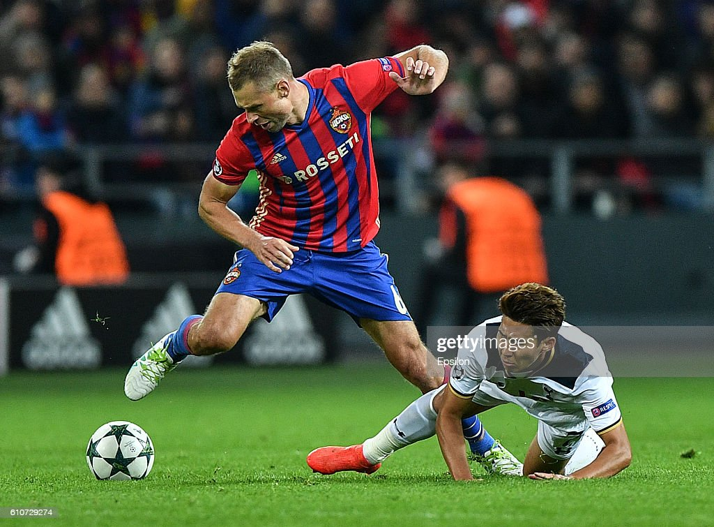 Aleksei Berezutski of CSKA Moscow vies for the ball with Heung-Min Son of Tottenham Hotspur FC during the UEFA Champions League match between PFC CSKA Moskva and Tottenham Hotspur FC at the CSKA Arena stadium on September 27, 2016 in Moscow.