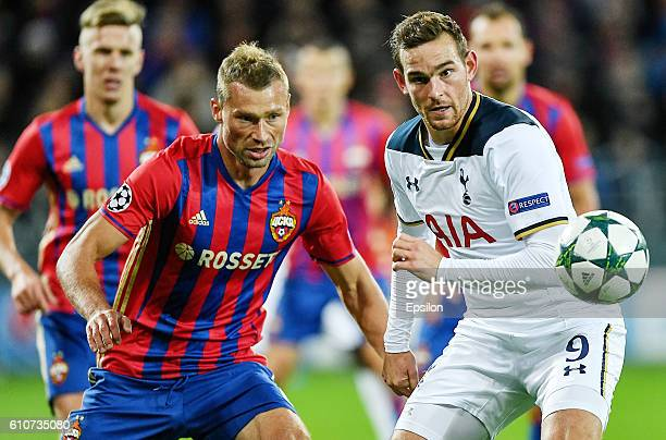 Aleksei Berezutski of CSKA Moscow vies for the ball with Vincent Janssen of Tottenham Hotspur FC during the UEFA Champions League match between PFC...