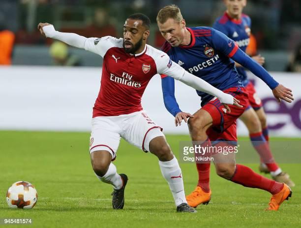 Aleksei Berezutski of PFC CSKA Moskva vies for the ball with Alexandre Lacazette of Arsenal FC during the UEFA Europa League quarter final leg two...