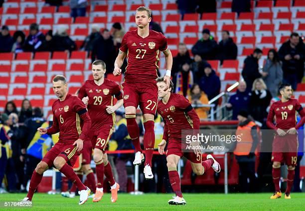 Aleksei Berezutski Oleg Ivanov Dmitri Tarasov and Pavel Mamayev of Russia National football team in action during the friendly football match between...