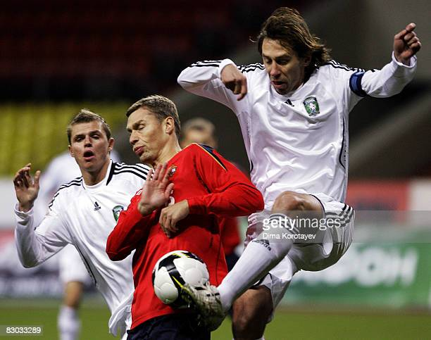 Aleksei Berezutskiy of PFC CSKA Moscow competes for the ball with Valeri Klimov and Dmitri Tarasov of FC Tom Tomsk during the Russian Football League...
