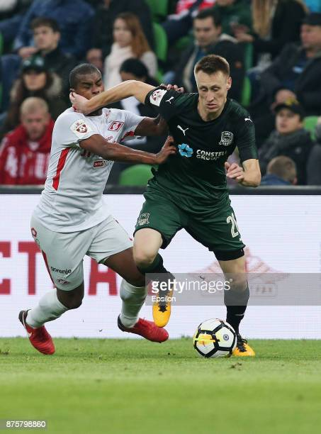 Aleksei Gritsayenko of FC Krasnodar vies for the ball with Fernando of FC Spartak Moscow during the Russian Premier League match between FC Krasnodar...