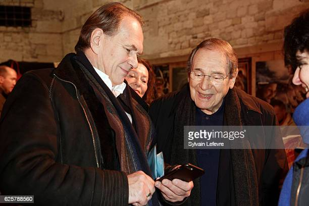 Aleksei Guskov and Robert Hossein speak together before the tribute to Robert Hossein during Russian Film Festival on November 25 2016 in Honfleur...