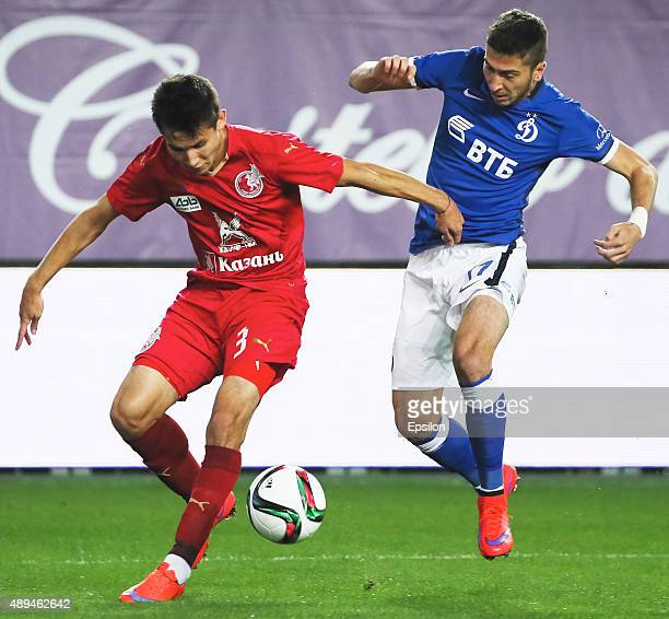 Aleksei Ionov of FC Dinamo Moscow is challenged by Elmir Nabiullin of FC Rubin Kazan during the Russian Premier League match between Dinamo Moscow...