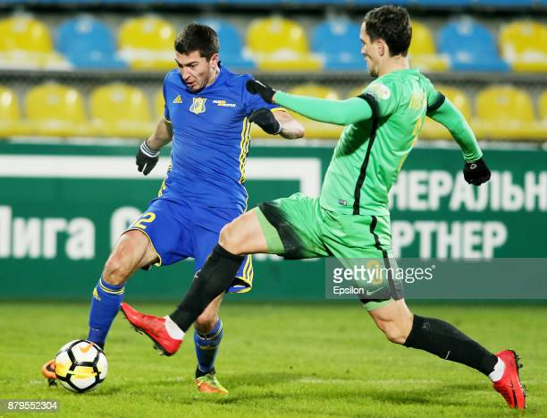 Aleksei Ionov of FC Rostov RostovonDon vies for the ball with Vladimir Poluyakhtov of FC Anzhi Makhachkala during the Russian Premier League match...