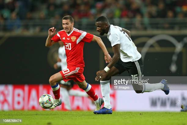 Aleksei Ionov of Russia and Antonio Ruediger of Germany battle for the ball during the International Friendly match between Germany and Russia at Red...