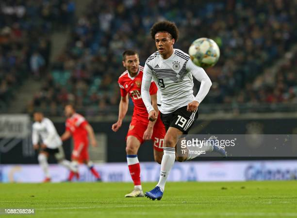 Aleksei Ionov of Russia and Leroy Sane of Germany battle for the ball during the International Friendly match between Germany and Russia at Red Bull...