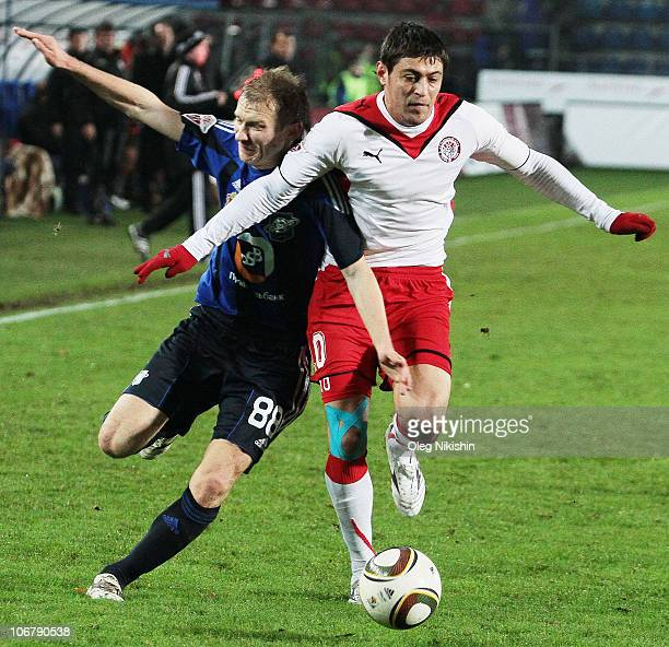 Aleksei Ivanov of Saturn Moscow Oblast and Andrei Topchu of Amkar Perm battle for the ball during the Russian Premier League match between FC Saturn...