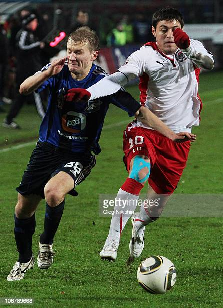 Aleksei Ivanov of Saturn Moscow Oblast battles for the ball with Andrei Topchu of Amkar Perm during the Russian Premier League match between FC...