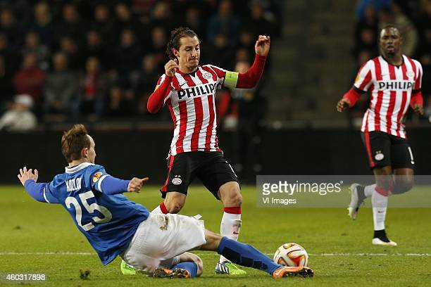 Aleksei Kozlov of Dinamo Moscow Andres Guardado of PSV during the UEFA Europa League group match between PSV Eindhoven and Dinamo Moscow on December...