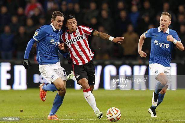 Aleksei Kozlov of Dinamo Moscow Memphis Depay of PSV Balazs Dzsudzsak of Dinamo Moscow during the UEFA Europa League group match between PSV...