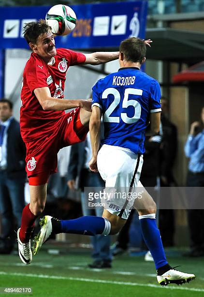 Aleksei Kozlov of FC Dinamo Moscow is challenged by Vladimir Dyadyun of FC Rubin Kazan during the Russian Premier League match between Dinamo Moscow...