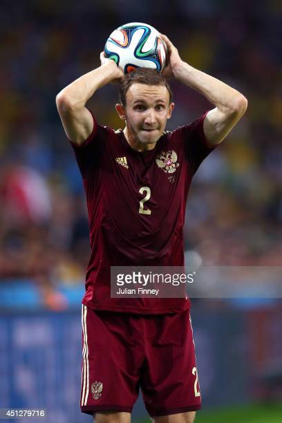 Aleksei Kozlov of Russia prepares for a throw in during the 2014 FIFA World Cup Brazil Group H match between Algeria and Russia at Arena da Baixada...