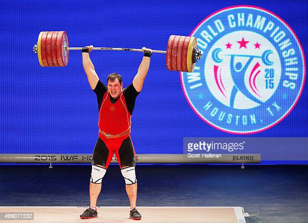 Aleksei Lovchev of Russia lifts a world record 264kg in the clean and jerk in the men's 105kg weight class during the 2015 International...