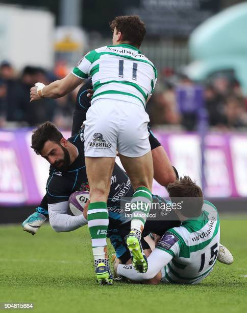 Aleksei Mikhaltsov of EniseiSTM is tackled by Simon Hammersley of Newcastle Falcons during the European Rugby Challenge Cup match between Newcastle...