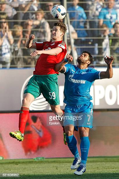 Aleksei Miranchuk of FC Lokomotiv Moscow and Hulk of FC Zenit St Petersburg vie for the ball during the Russian Football League match between FC...