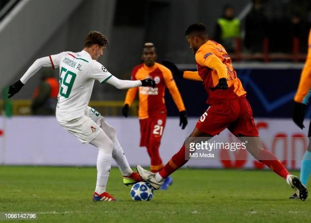 Aleksei Miranchuk of FC Lokomotiv Moscow and Ryan Donk of Galatasaray vie for the ball during the Group D match of the UEFA Champions League between...